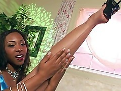 Ebony babe playing with nylons and dildo