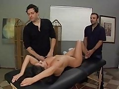 Busty brunette slut gets full body massage by two hot studs