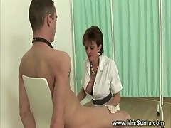 Mature nurse giving a handjob