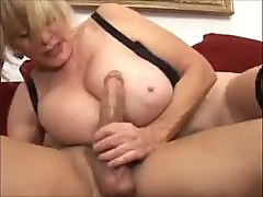 Foxy mature with huge tits loves young cock