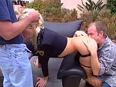 Police woman fucked by two guys outdoors
