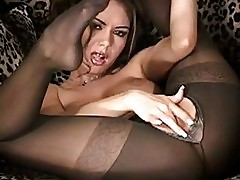 Sexy Crissy Moran rubs her wet pussy wearing hot black stock...