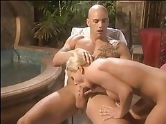 Blonde pornstar doing blowjob to bald tattooed stud by the p...
