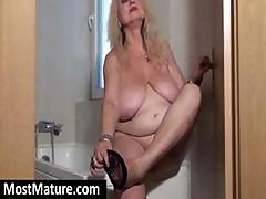 Blonde Granny With Saggy Bit Tits Rubs Her Pussy In The Bathroom