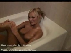 Big titted college student masturbates in the bathroom