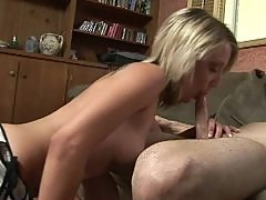 Blonde girl with tattoo giving her boyfriend blowjob