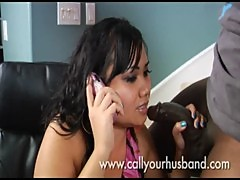 Thea Talks To Her Husband On The Phone While Blowing A Big Black Cock