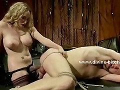 Submissive hunk gets tied up and dominated by a gorgeous blonde that fucks his ass with a strapon