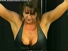 Beautiful slave with big tits and her hands tied got spanked