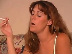 Brunette floozy sucked while puffing a smoke