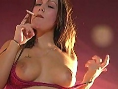 Megaboobed whore smokes while masturbating