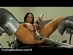 Huge tits brunette squirts on fucking machine