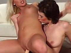 Magdalana fucks Gina Blond with strap on dong