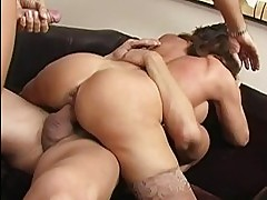 Naughty brunette busty milf getting gangbanged by two huge c...